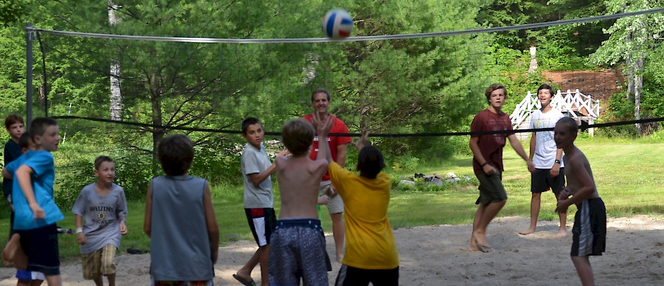 "Feeling energized and optimistic after Rest Hour, campers challenge staff to a game of Beach Newcomb.  Afternoons at camp involve games, sports and ""free swim"".  On a hot afternoon, several encampments will likely be sharing the camp waterfront.  Dinner is at 6:00PM."