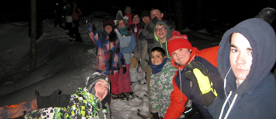 "NH Week campers enjoy a traditional ""last night of camp"" mystery snowshoe adventure."