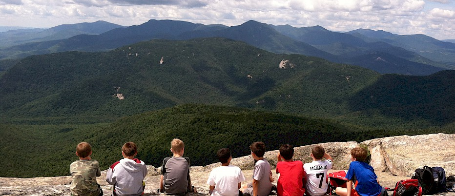 A group of camp friends share a spectacular summit view.  And although their time together at the summit is short, they will share the memories of this trip together forever.