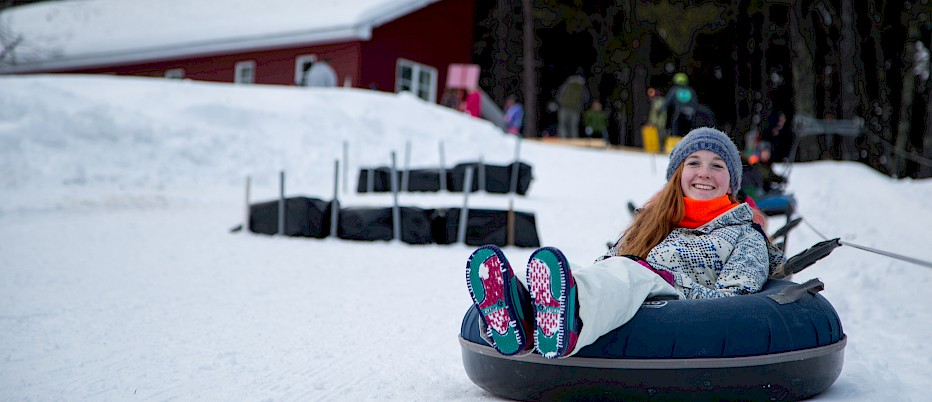 Life appears good for this camper, enjoying a relaxing ride on the Tubing Hill.
